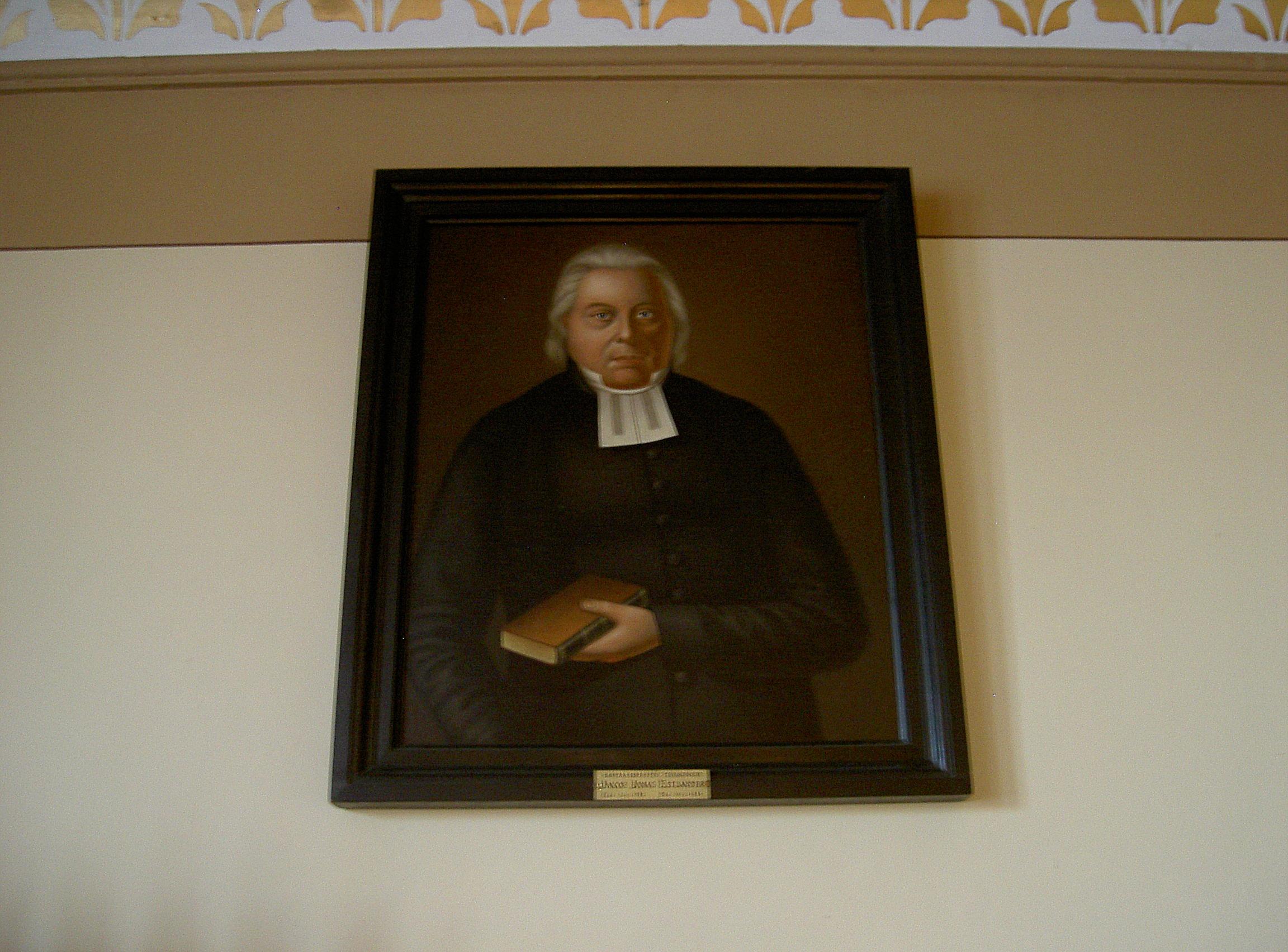 Den här tavlan målade Herman Adrian Barkman, föreställande kyrkoherden Jakob Jonas Estlander. Dem har hängt i sakristian i Lappfjärds kyrka ända sedan den byggdes.